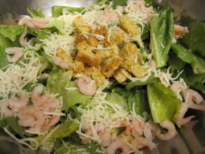 shrimp caesar salad ready to be tossed