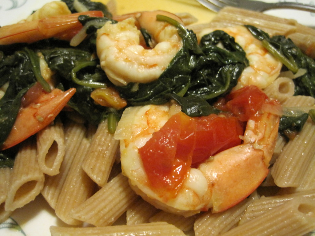 shrimp cooked with garlic, scallions, tomatoes, and spinach makes a delicious meal
