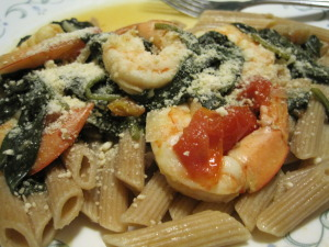 Shrimp with spinach, tomatoes, wine, garlic, and pasta.