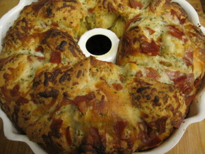 pepperoni pizza pull apart bread after it comes out of the oven.