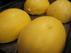 Spaghetti squash in pan with water
