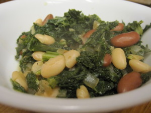 beans and greens steaming after being ladled into a bowl
