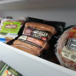 frozen sausages and hot dogs purchased at the lowest price can help stretch your grocery budget