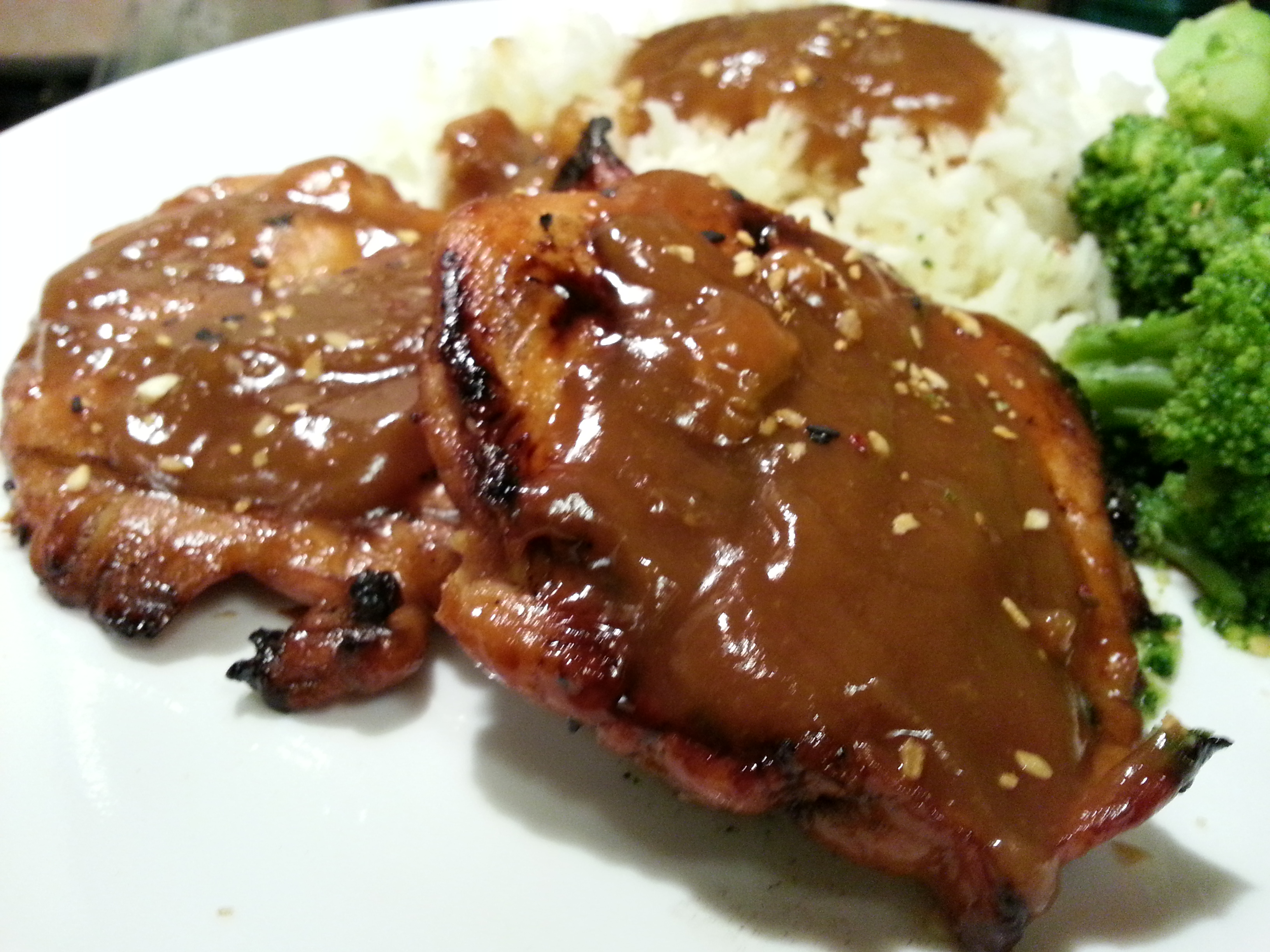 Thickened teriyaki sauce on meat and rice