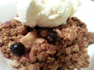 blueberry pear crumble served ala mode with vanilla icecream