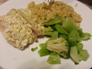 Creamy baked tilapia served with rice pilaf and broccoli