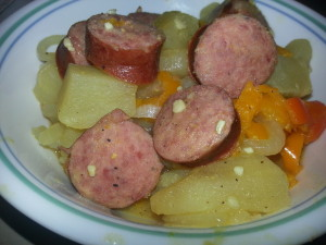hearty and inexpensive meal made from potatoes, smoked sausage and vegetables.