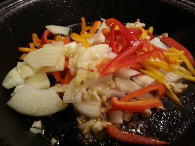 Add garlic, pepper, and onion to the pan.