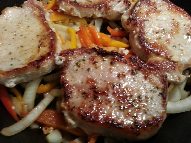 Arrange the pork chops on top of the vegetables