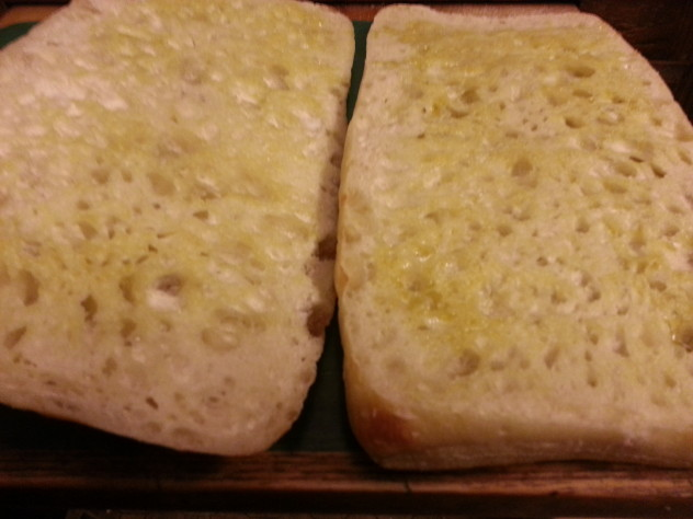 brush olive oil on the cut side of the bread