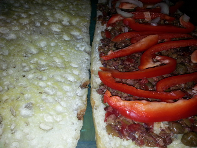 peppers and onions top the olive tapenade