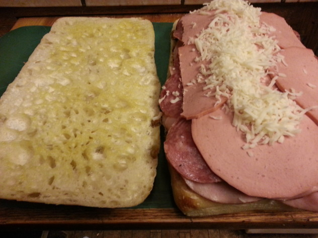 shredded mozarella cheese on top of meats