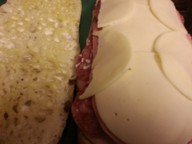 the sandwich is topped with sliced provolone