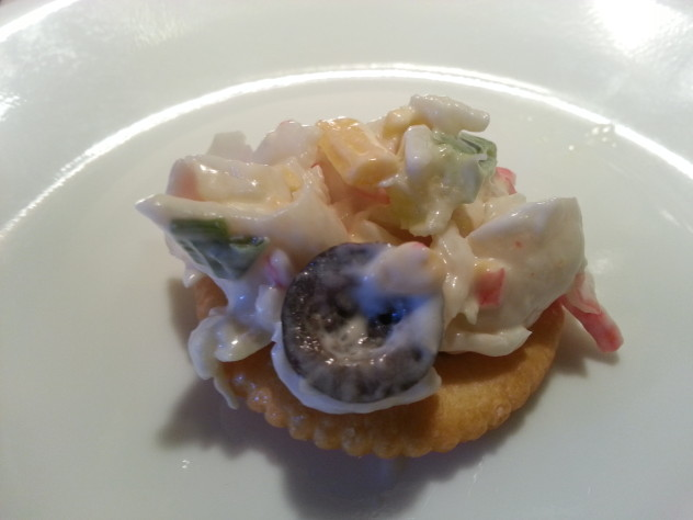 cracker topped with crab salad