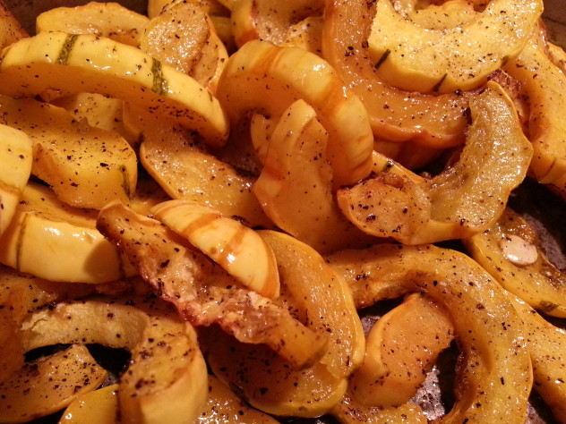delicata squash that has been roasted in the oven and is ready to be served.