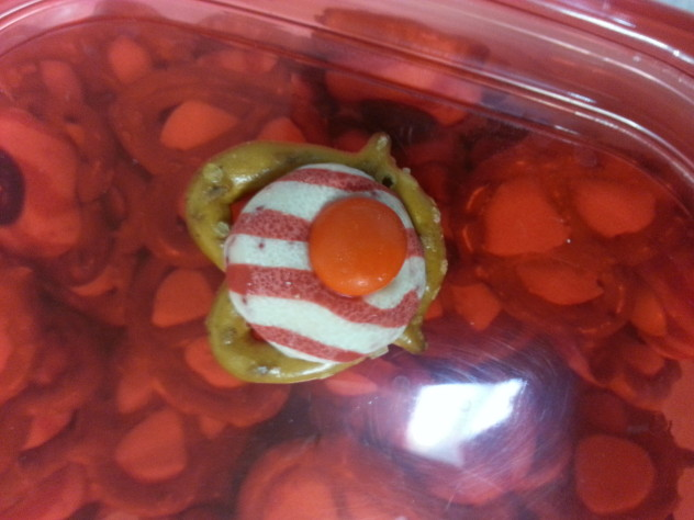 Peppermint kiss melted on pretzel and topped with m&m