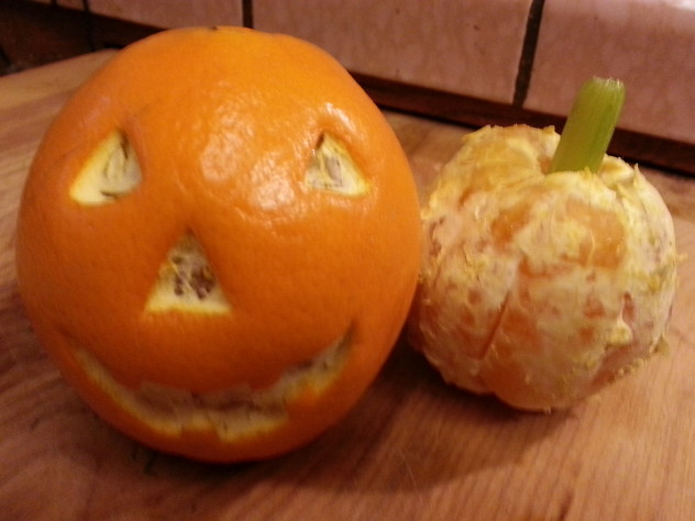 an orange pumpkin and an orange jack-o-lantern