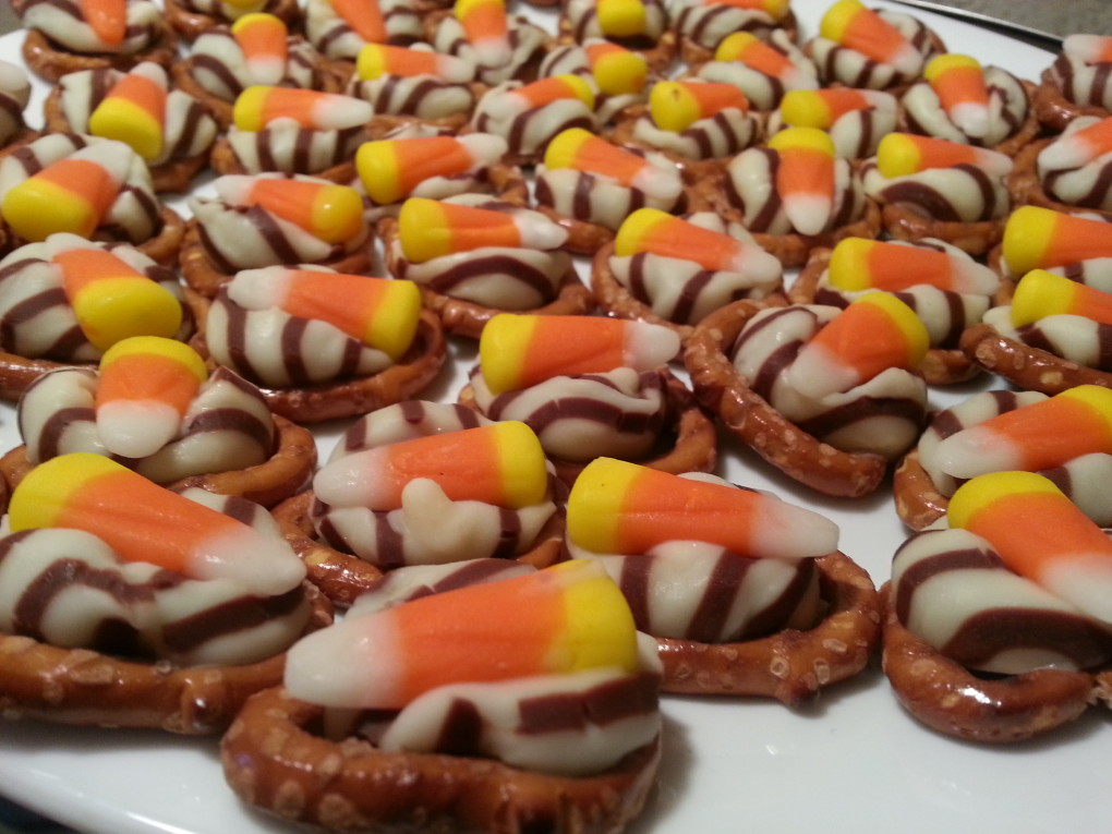 candy corn, a hug, and a pretzel make halloween candy.