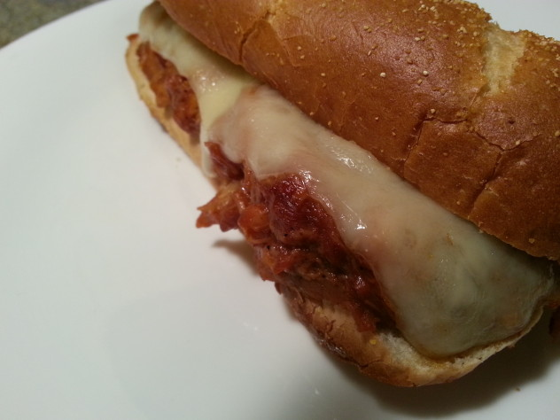 bbq turkey sandwich with melted swiss cheese