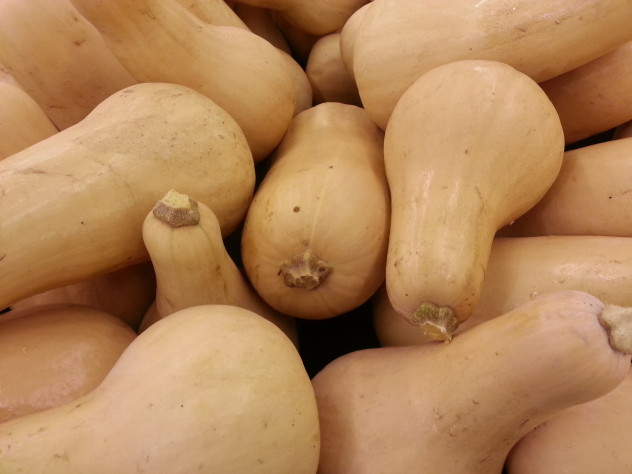 a bin of butternut squash for sale