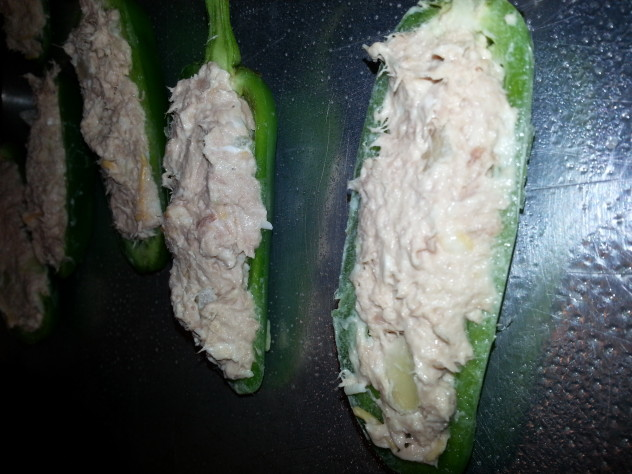 tuna filling is stuffed into the cavity of the jalapeno