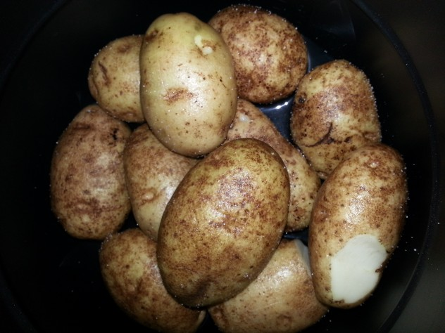 Potatoes and water in pressure cooker ready to be baked