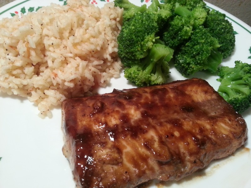 The plated dinner of tomato rice and broccoli served with maple Dijon glazed salmon.