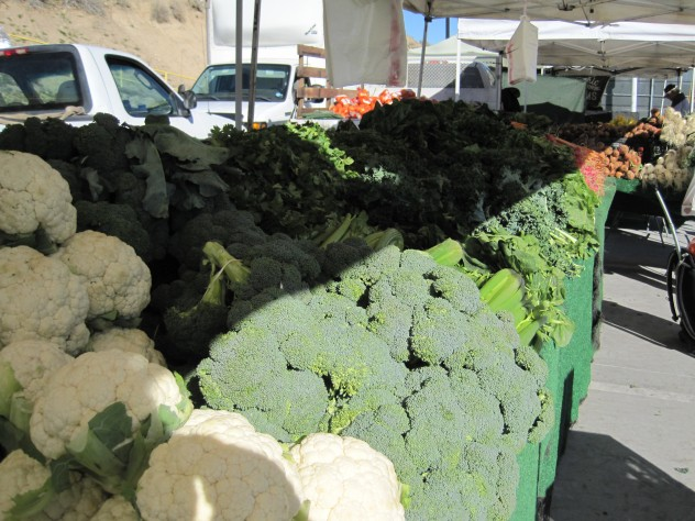 cauliflower and broccoli along with other seasonal vegetables at the farmers market