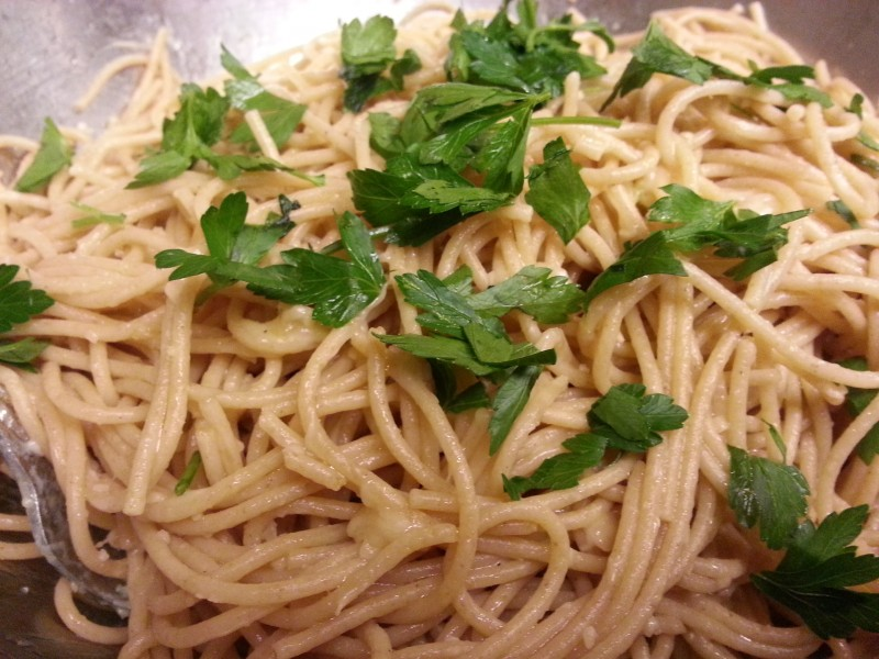 Spaghetti Parmesano is made from a simple combination of garlic, olive oil, red pepper flakes, and Parmesan cheese.