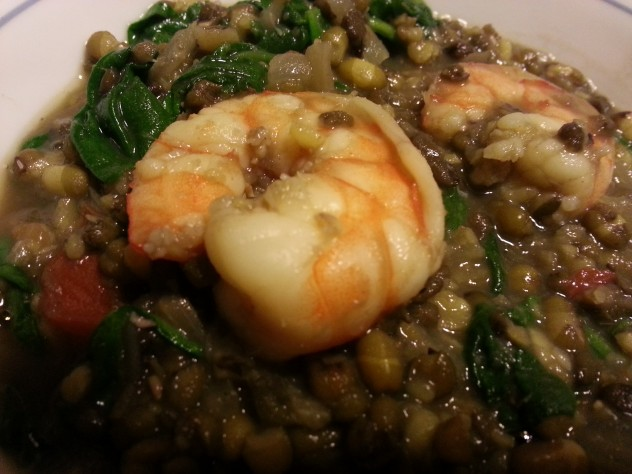 mongo guisado in a bowl with shrimp on top.