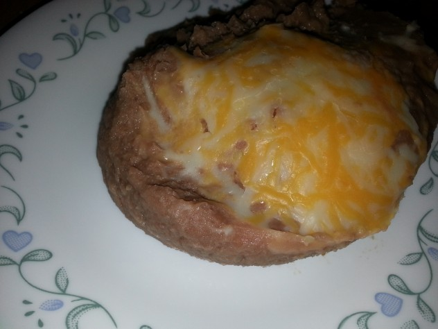 cheese melts atop easy refried beans