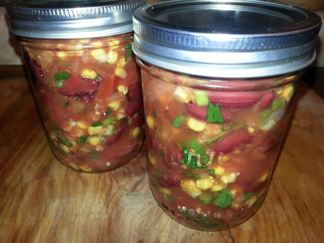 kidney bean and corn salad stored in mason jars in the fridge