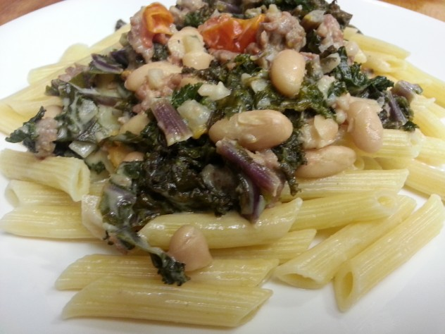 Penne topped with a creamy sauce loaded with canellini and kale