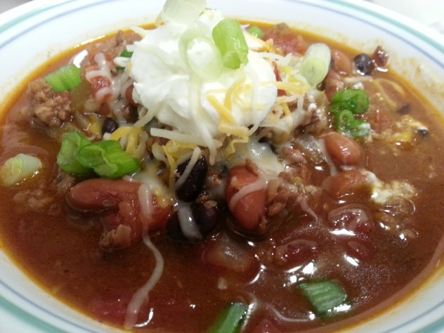 sour cream, shredded cheese and green onions make a great topping for taco bean soup made in the pressure cooker.