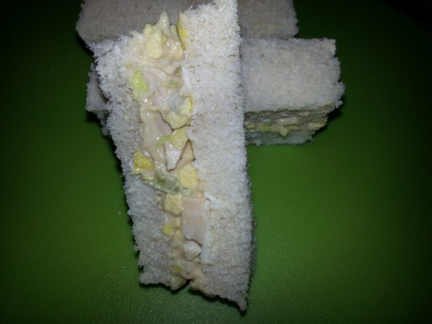 Finger sandwiches filled with egg salad