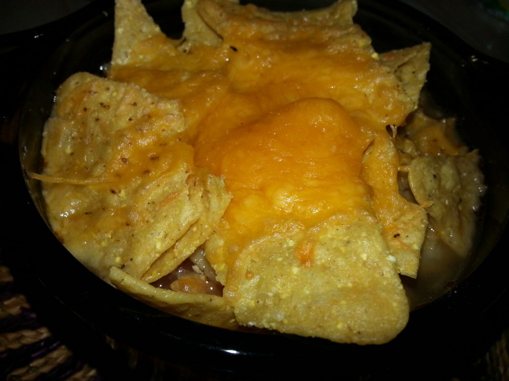 Chicken Tortilla soup, topped with chips and melted cheese