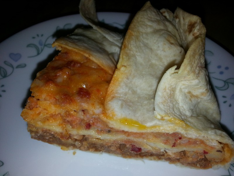 The burrito pie is cut for serving