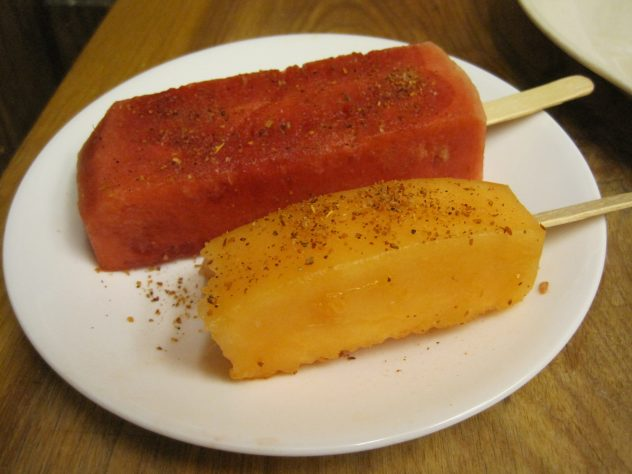melon-sicles sprinkled with Tajin and Lime