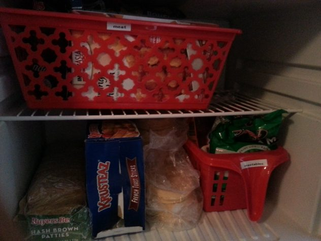 Organizing a Small Fridge and Freezer--inexpensive baskets from the dollar store help provide organization to a small freezer, making it easy to find what you want and see what you need to buy.