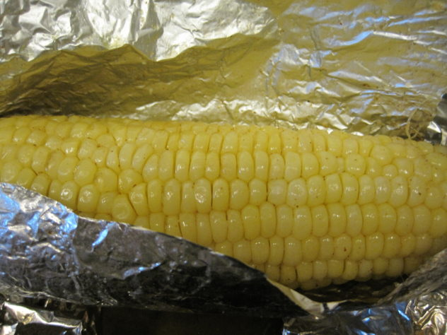 Grilled corn, wrapped in foil
