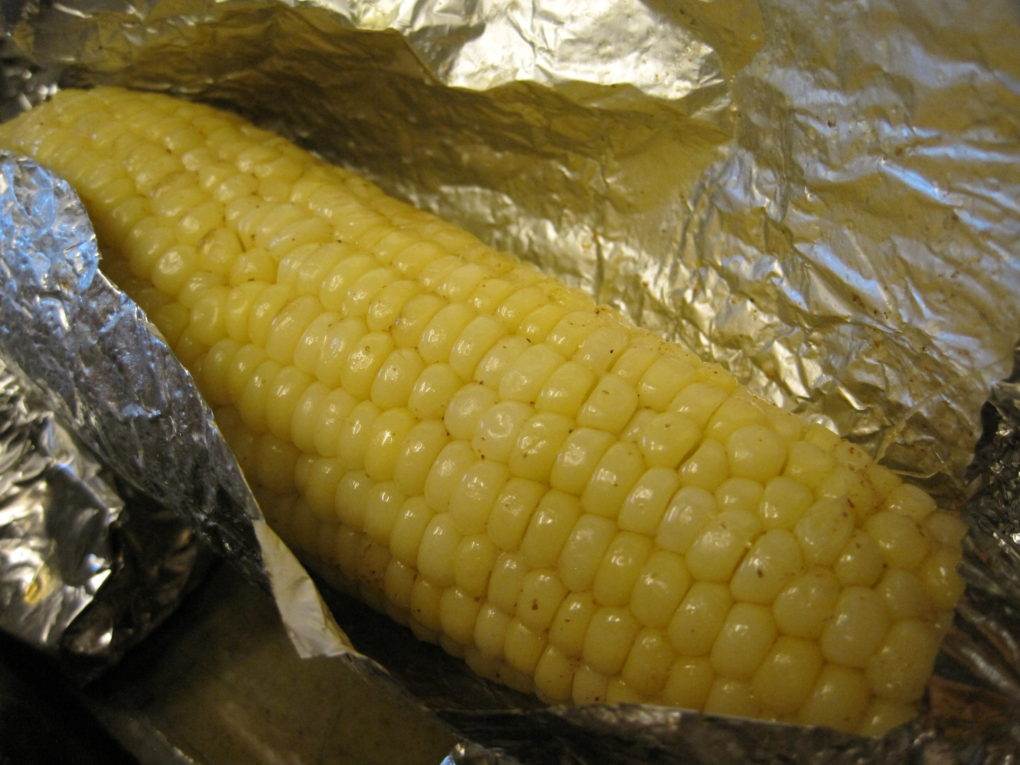 Grilled corn, preseasoned then wrapped in foil