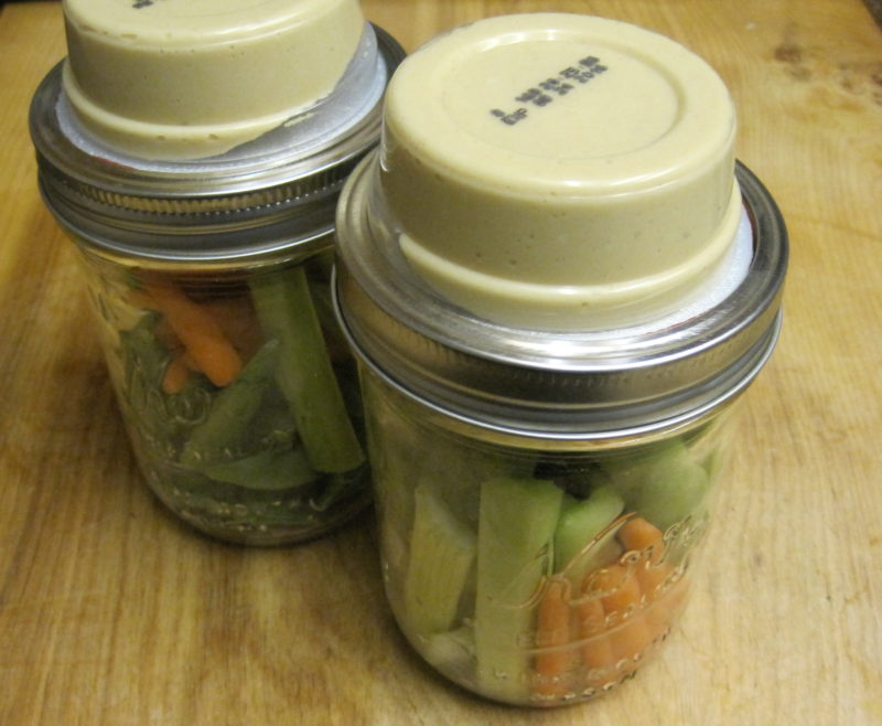Veggie and Hummus Jars--What can be better than hummus and veggie jars? Fresh cruciferous vegetables are arranged in a wide mouth mason jar that is topped with a 2 ounce sized serving of hummus. The perfect healthy grab and go lunch.