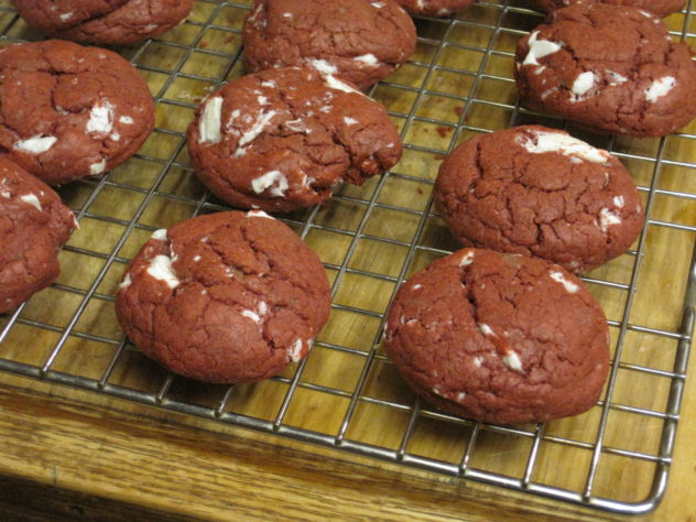 These colorful red velvet cookies are delicious and easy to make. The recipe starts with a red velvet cake mix.