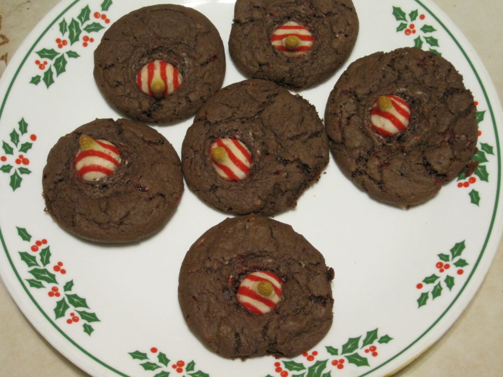 Peppermint Mocha Cake Mix Cookies topped with a peppermint kiss