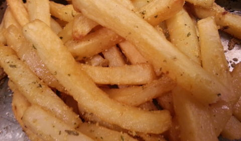 Frozen French Fries tossed with garlic butter and sprinkled with parmesan cheese are delicious.