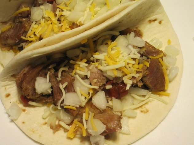 Taco seasoned pork meat cooked all day in the slow cooker. Delicious!