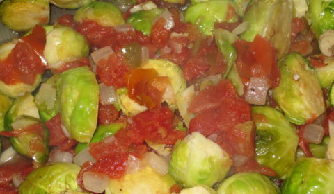 Spicy Brussel Sprouts and Tomatoes--Brussel sprouts roasted in a a mixture of onions, tomatoes, and diced green chilies. Delicious!