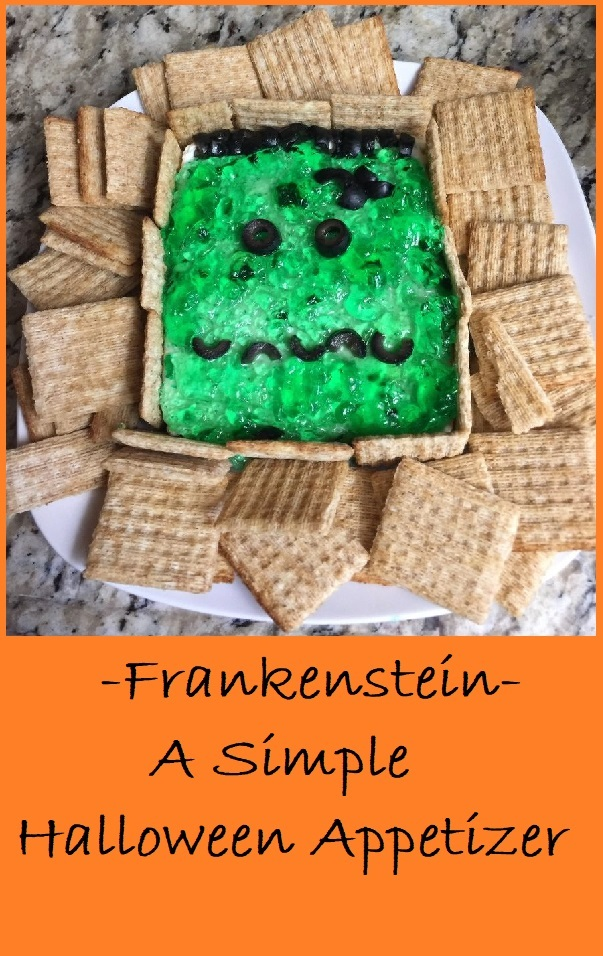 Frankenstein Appetizer--A simple combination of cream cheese, jalapeno pepper jelly, and sliced olives is perfect for your Halloween party
