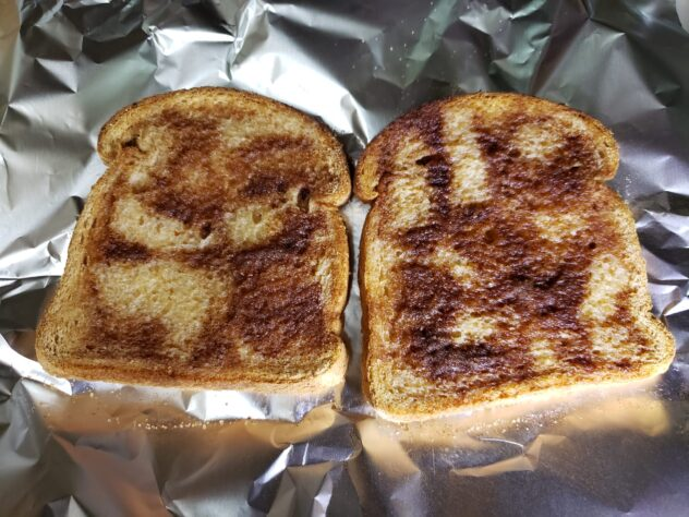 two slices of cinnamon toast with carmelized sugar and cinnamon on top