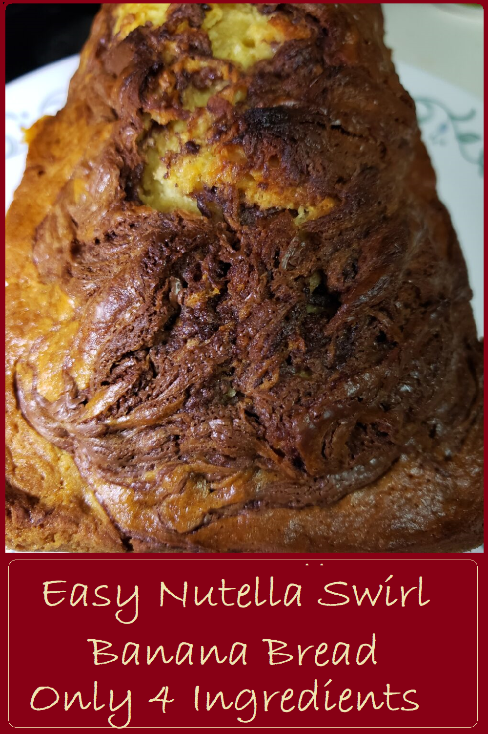 Top view of a loaf oa Nutella Swirl Bread. The loaf along the top has visible swirls of chocolate, and is cracked.